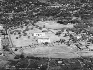 Aerial photograph, 4 April 1926, shows George Hall (the Library) and Gartley Hall, the two newest buildings of the era. Note that University Avenue extends from Vancouver Highway in Mānoa Valley makai to Metcalf Street. (University Archives Photograph OURD 99B)