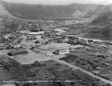 Aerial photograph, 4 April 1932, shows several changes in the six intervening years: University Avenue extends all the way makai to Mōʻiliʻili; Wist Hall, Atherton House, Farrington Auditorium, and the Gymnasium have been built. (University Archive Photograph OURD 231A)