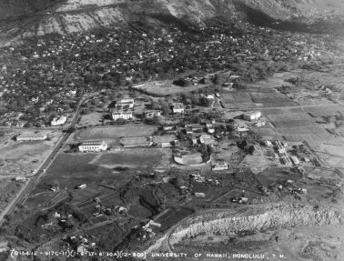 Aerial photograph, 6 January 1937, shows Andrews Amphitheatre, old Gilmore Hall, an expanded Pineapple Research Institute (now Krauss Hall), and Campus Gate. Dole Street runs from McCully area (beyond the left margin of photograph) to University Avenue. Note also the distance between the quarry edge and Andrews Amphitheatre. (University Archives Photograph OURD 227A)