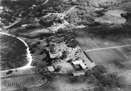 Aerial view of campus, late 1910s, showing Hawaiʻi Hall and the first building of the Engineering Quad, the two oldest buildings still standing on campus. Beau Press currently (as of 2002) occupies this part of the Engineering Quad. (University Archives Photograph OURD 220)