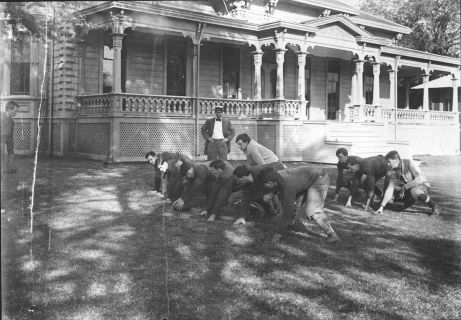 Early College of Hawaiʻi football team practices outside the Maerten House, home of the College of Hawaiʻi, 1908 - 1912 (University Archives Photograph)