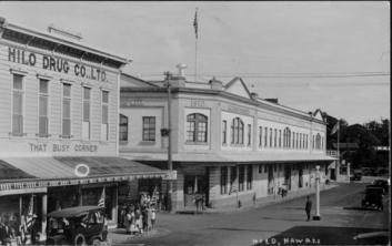 Downtown Hilo, Hawaii Island. Hilo Drug Co., Ltd. near left and American Factors across street.- ca 1928
